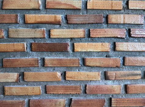 Abstract, imperfectly built brick wall with rough plaster.