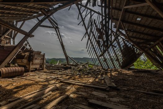 broken loft of a farm with a view of the landscape