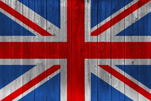 United Kingdom flag painted on old wood plank. Patriotic background. National flag of United Kingdom