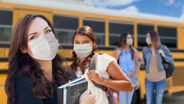Students Near School Bus Wearing Medical Face Masks During Coronavirus Pandemic