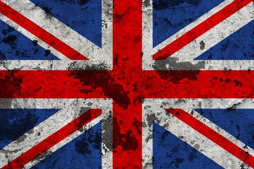 United Kingdom flag on old wall. Patriotic grunge background. National flag of United Kingdom