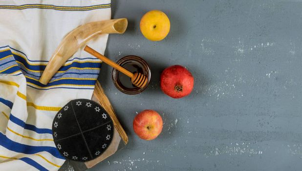 Rosh hashanah with glass honey jar and fresh ripe apples. Jewesh new year symbols shofar and tallit
