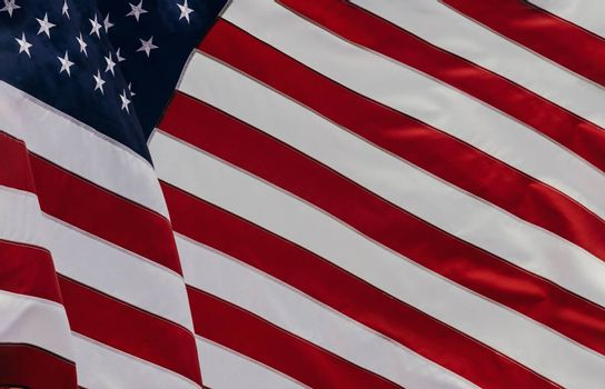 The USA flag beautifully waving star and striped American flag