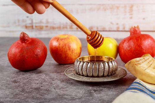 Orthodox Jewish holiday in the synagogue are symbols of Rosh Hashanah apple and pomegranate, shofar talith