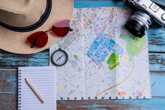 Compass and camera on map for travel planning