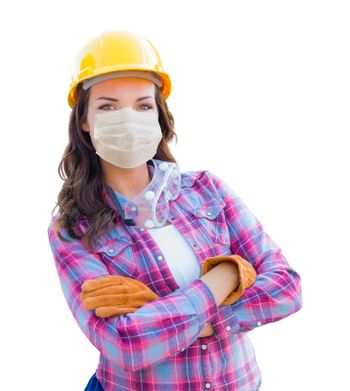 Female Contractor In Hard Hat Wearing Medical Face Mask During Coronavirus Pandemic Isolated on White.