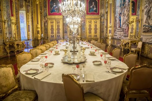 VENARIA REALE, ITALY - CIRCA AUGUST 2020: luxury dining room in Baroque style  with gala dinner table setting