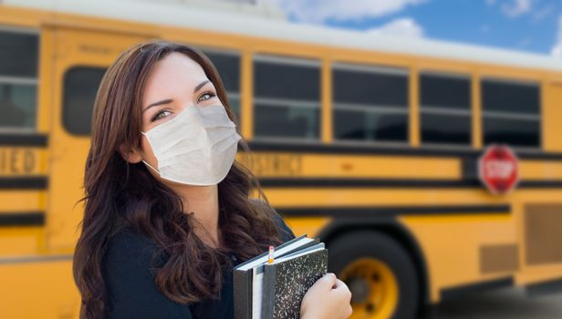 Female Student Near School Bus Wearing Medical Face Masks During Coronavirus Pandemic.
