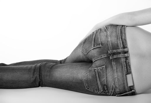bottom of a woman in blue jeans