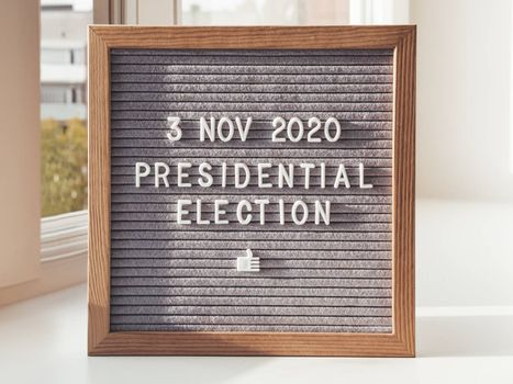 Announcement of USA Presidential Election at 3rd November 2020. Call to go to the vote. Letter board on white window sill.