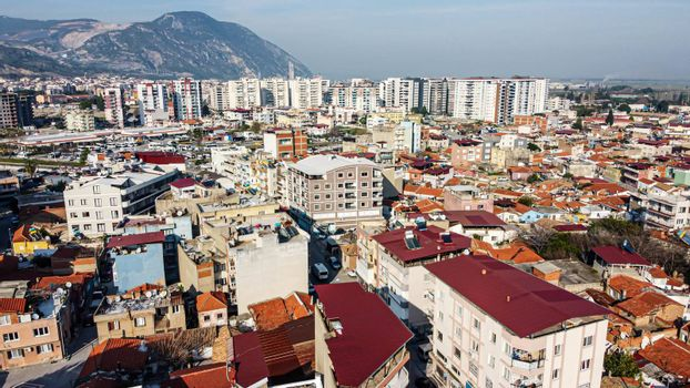 an aerial shoot with modern colors of a little town - there is many buildings. photo has taken at aydin/turkey.