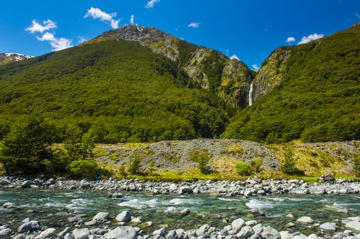Bealey River in front and Devil's Punchbowl Waterfall in the back could be found in the Arthur's Pass National Park, New Zealand