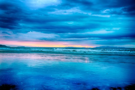 Blue surreal sunset over the sea in the New Zealand