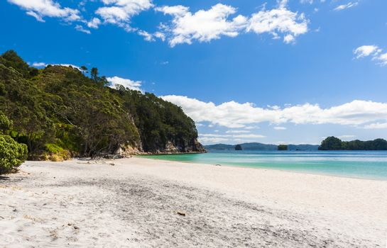 Photo of a beautiful white sand Hahei beach at Cathedral Cove Marine Reserve, Coromandel Peninsula, New Zealand.