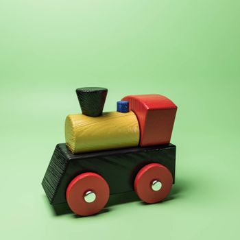wooden train isolated on green background 3d illustration