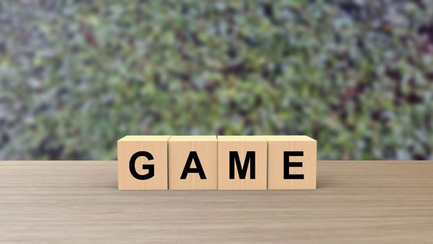 Game word wooden cubes on table vertical over blur background with climbing green leaves, mock up, template, banner with copy space for text, play video games, gambling online, illustration 3d render