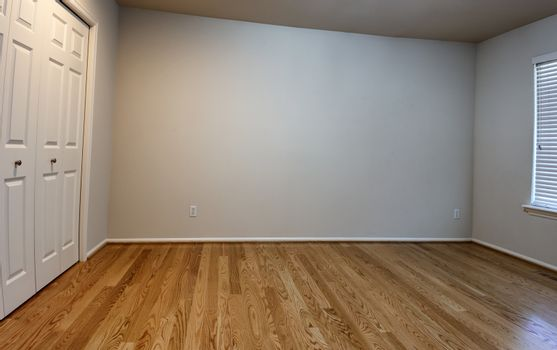 Newly installed red oak floor for bedroom in home