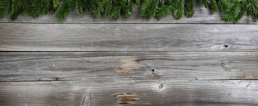 Merry Christmas and Happy New Year fir branches on rustic wooden boards