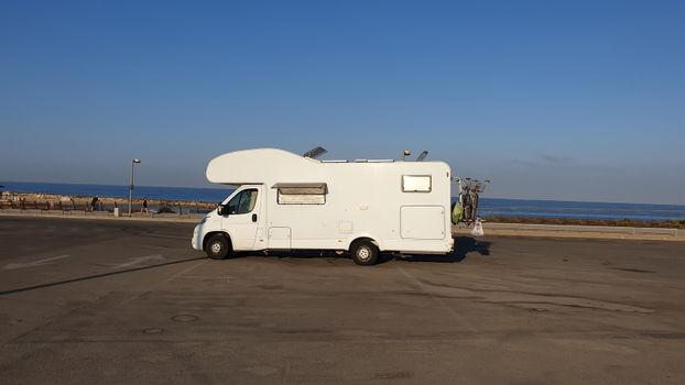 Self-propelled recreational vehicle parking at the coast. RV offers accommodation combined with a vehicle engine