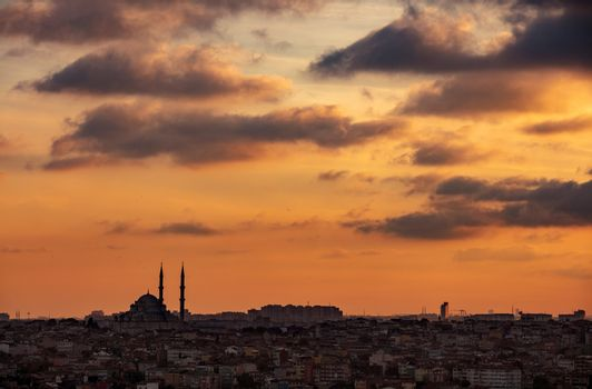 Evening View on Istanbul City. Silhouettes of Mosque and Minarets over Beautiful Orange Sunset Sky Background. Travel to Turkey.