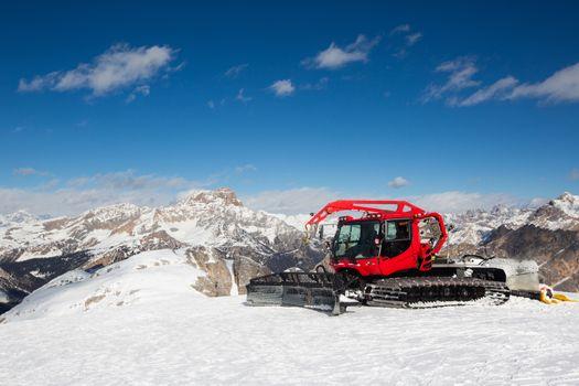 Red snowcat ratrack mountain panorama