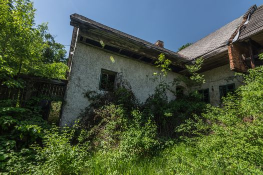 old house with overgrown garden in nature