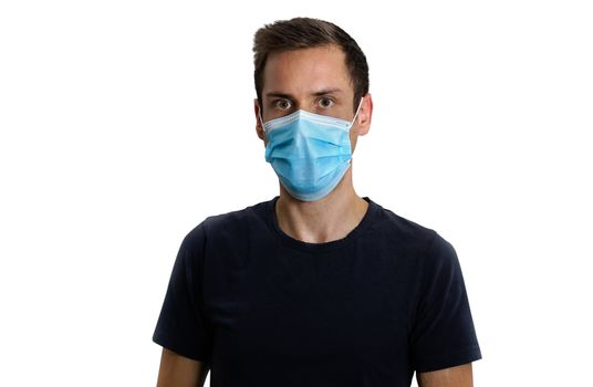 handsome young  man in black t-shirt wearing medical mask on isolated white background.