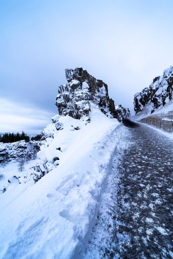 snowy wintry footpath in iceland. path that leads up the mountai