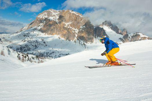 Alpine skier on slope at Cortina