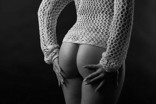 the bottom of a woman in a sweater