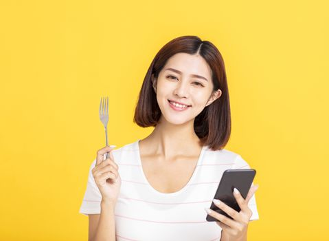 happy young woman searching for restaurant by smart mobile phone concepts