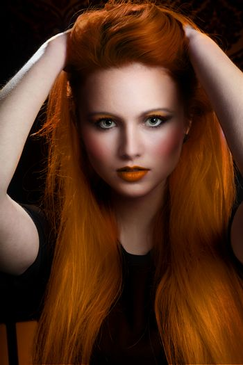 pretty girl with very long orange hair and green eyes. heavy makeup and clean face. Model with pretty face