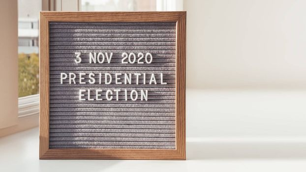 Announcement of USA Presidential Election at 3rd November 2020. Call to go to the vote. Letter board on white window sill. Copy space.