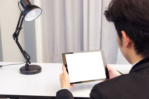 Back view of Businessman video conference by tablet