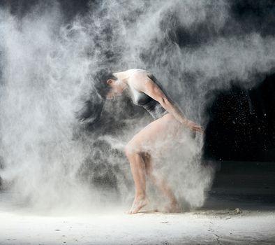 beautiful caucasian woman in a black bodysuit with a sports figu