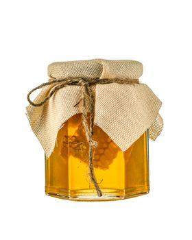 Honey jar close up isolated