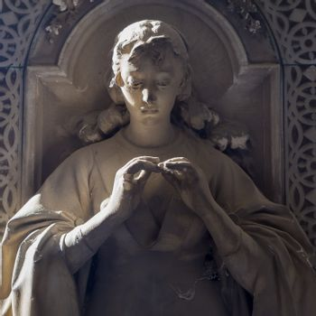 GENOA, ITALY - June 2020: antique statue, beginning 1800, made of marble, in a Christian Catholic cemetery - Italy