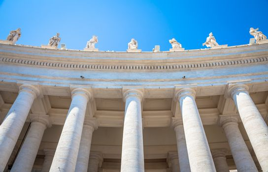 Rome, Vatican State. Details of columns of Saint Peter Square with copyspace on blue
