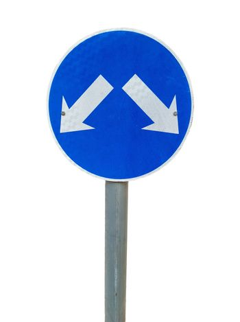 Road sign pointing at two directions. Isolated on white. Alternative and multi choice concept.