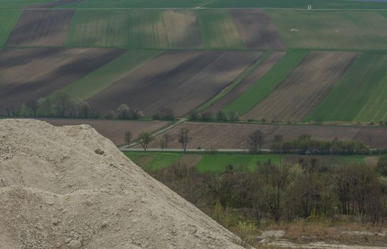 limestone quarry with a view of fields in spring