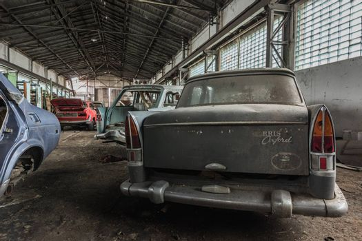 car morris oxford in an abandoned car hall