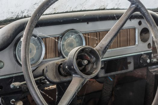 dashboard and steering wheel of an old car in a hall