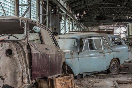 detail of old abandoned car repair shop