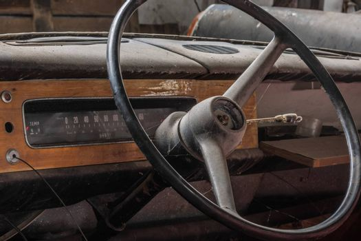 Steering wheel and dashboard from an old car Detail view