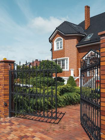 Gate is open to territory of house in suburbs of Kaliningrad. We