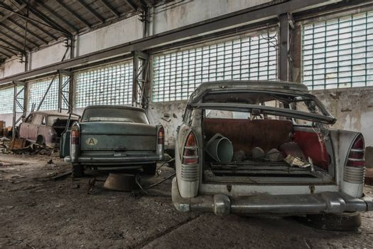 demolished cars in a hall rear view