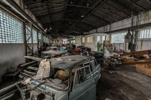 many old cars in a long hall top view