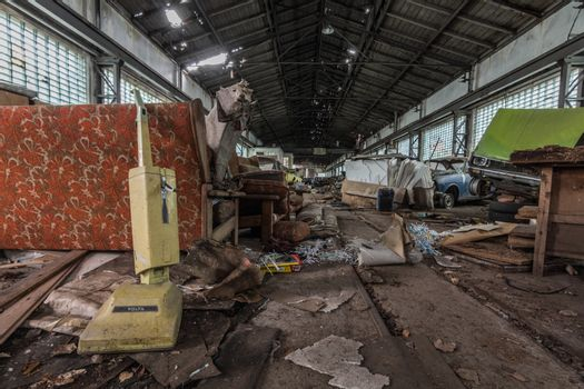 old brown vacuum cleaner in an abandoned car hall
