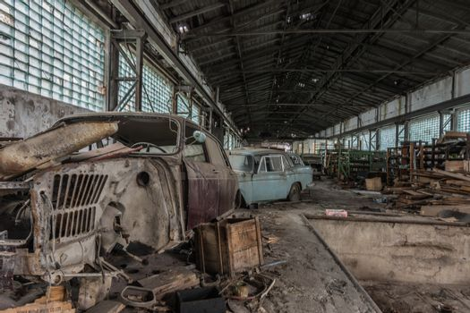 broken old car in a long hall