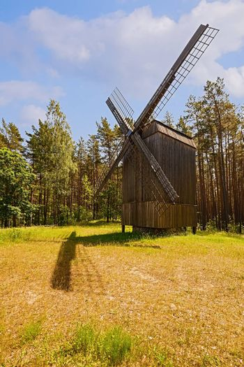 Old wooden windmill in rural area, Riga, Latvia